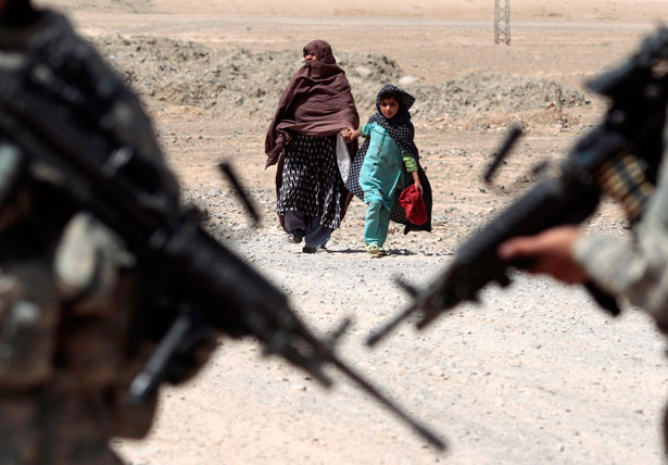 An Afghan woman approaches US soldiers