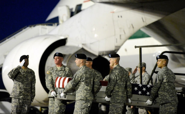 The body of a soldier who died in Afghanistan is offloaded at Dover Air Force Base in September.